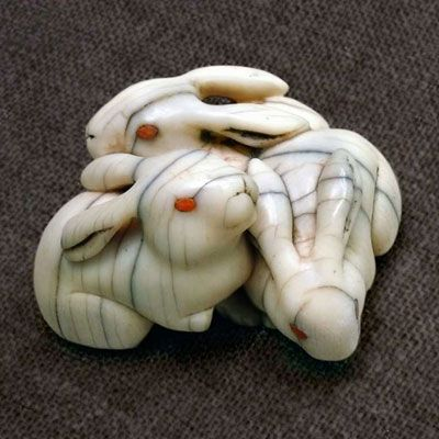 """Netsuke """"Three Rabbit"""" - a traditional kimono accessory. Netsuke (根付?) are miniature sculptures that were invented in 17th-century Japan to serve a practical function  and act as decoration and hung from the obi."""