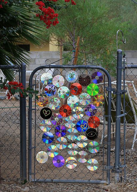 Disc decorations cd 39 s on a gate by cobalt123 via flickr for Sensory garden designs
