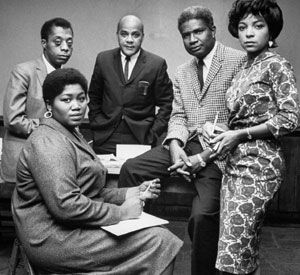 Folk singer Odetta (l), writer James Baldwin (l), writer John Oliver Killens (m), actor Ossie Davis (r) and actress Ruby Dee (r) in New Rochelle, NY (October 1963).
