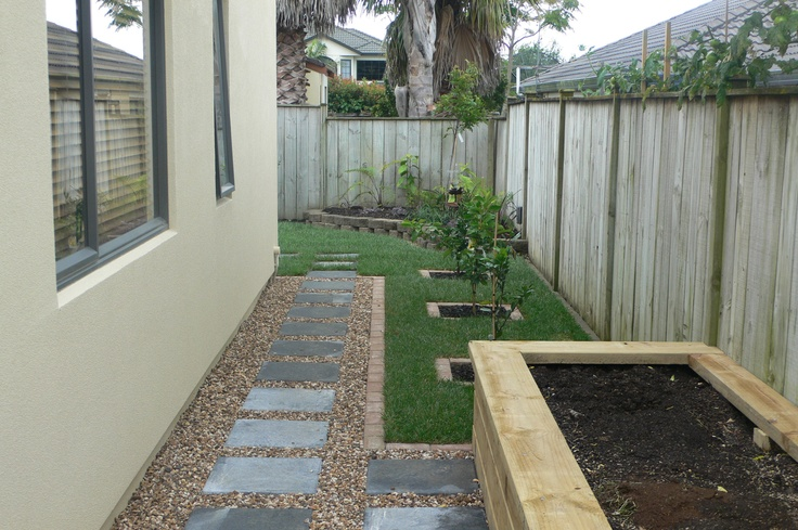 A sunny, narrow waste land turned into a functional, attractive and productive raised vege garden with citrus trees set into lawn area. Designed and implemented by Fusion Landscape Design. www.fusionlandscapedesign.co.nz