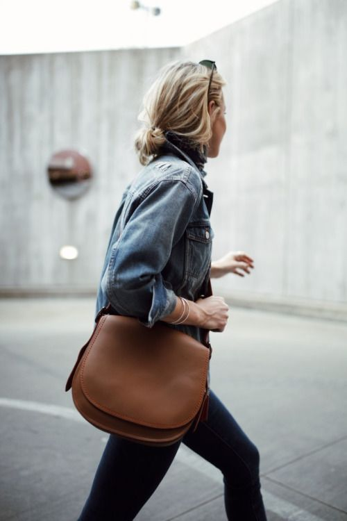 denim jacket, black jeans, brown saddle bag