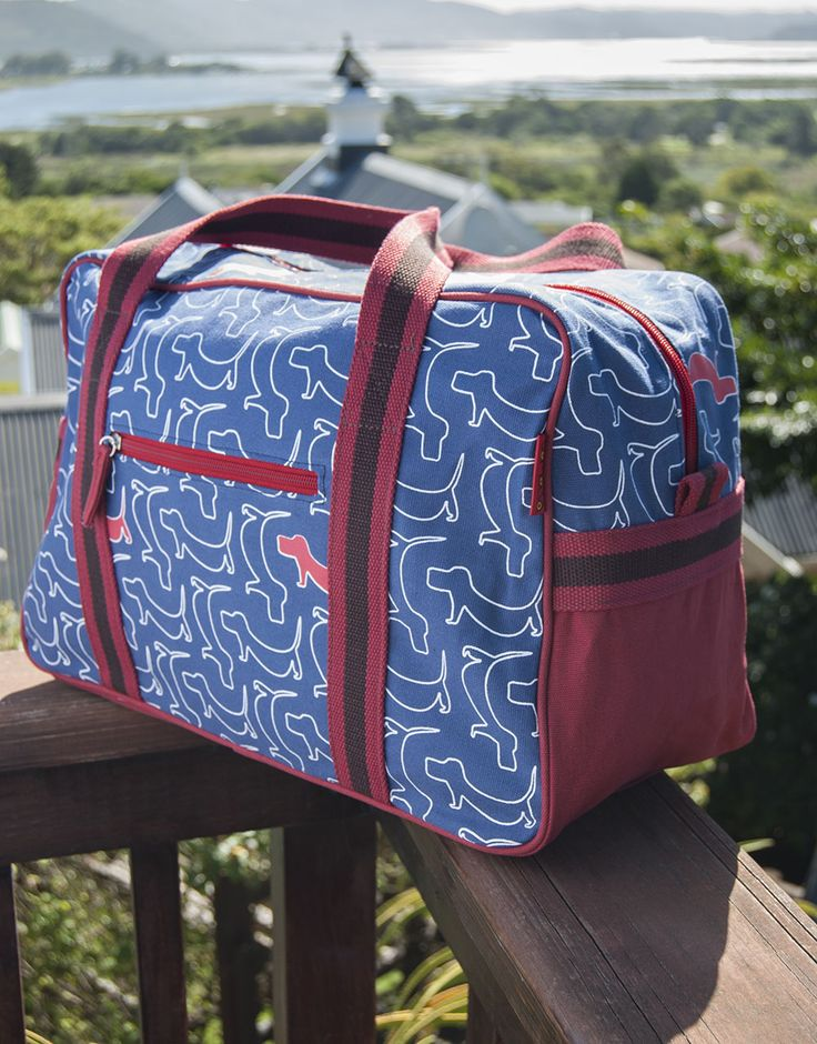 Tamelia Weekend Bag in Dogs print - the perfect getaway bag to hold all your travel necessities!