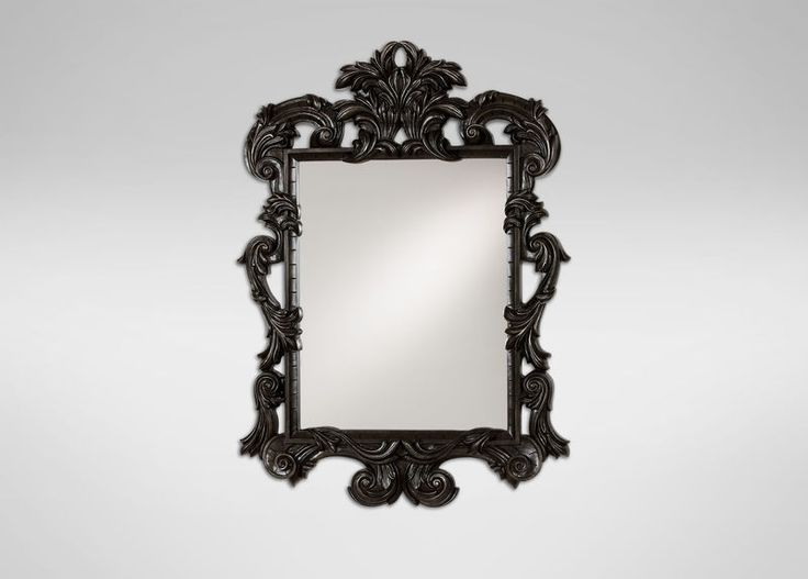 Black Ornate Mirror.  It's a tremendous statement piece: modern, bold, and dramatic in glossy black or white.  Shop at the Ethan Allen of Orland Park, IL. design center.