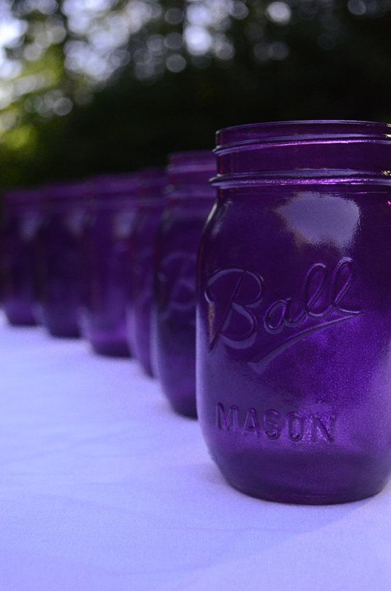 Purple Mason Jars, more simple but paired with orange and dark blue and white flowers with a petals.