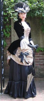 From the Steampunk Fashion Guide to Skirts & Dresses: Bustle Skirts - an example of a woman wearing a victorian costume with a bustle skirt