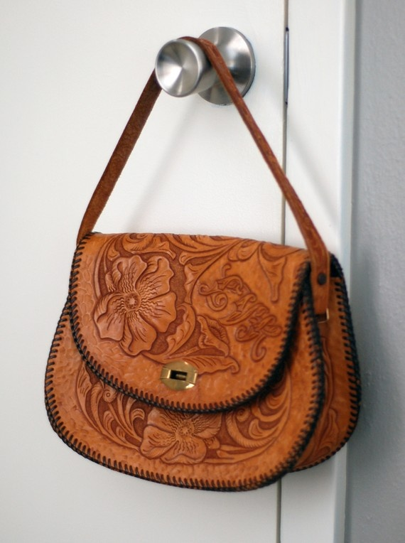 Tooled leather purse.