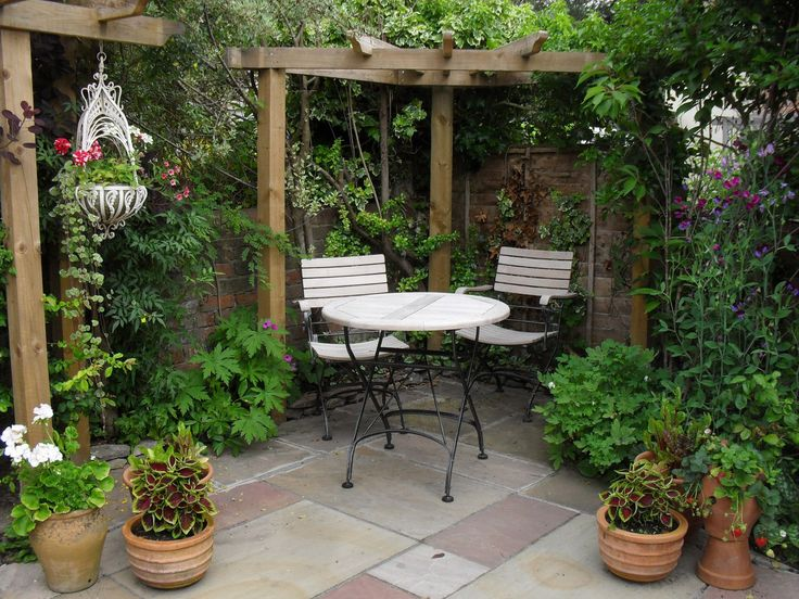 Courtyard Garden Design for Modern Home : Small Courtyard Gardens Design  Corner Pergola Outdoor Dining Set-this might do