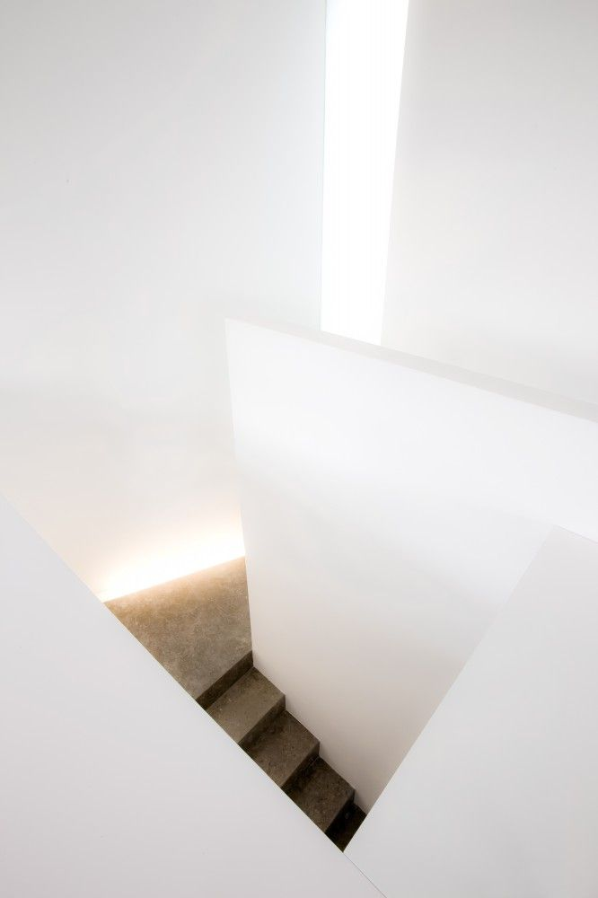 White interior with grey stairs. House in Valencia by Ramón Esteve, photo by Fernando Alda.