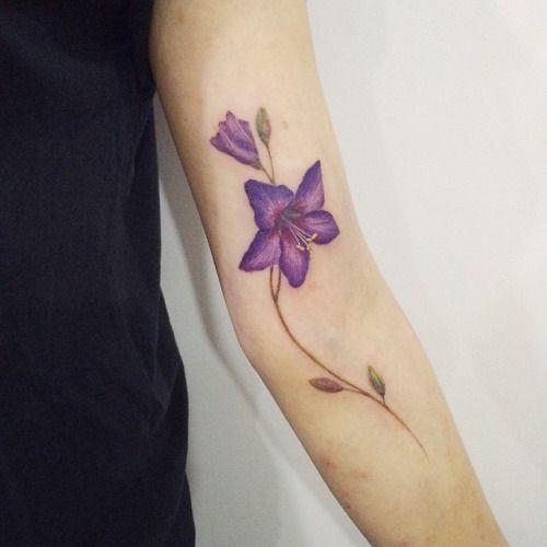 : Violet flower tattoo #tattoo #tattooistdoy #tattooworkers...