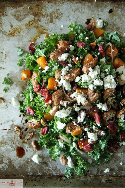 Kale salad with roasted pumpkin, cranberries and goat cheese.