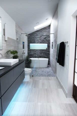 Contemporary Master Bathroom with European Cabinets, frameless showerdoor, Slate counters, Rain shower, Wall sconce, Skylight