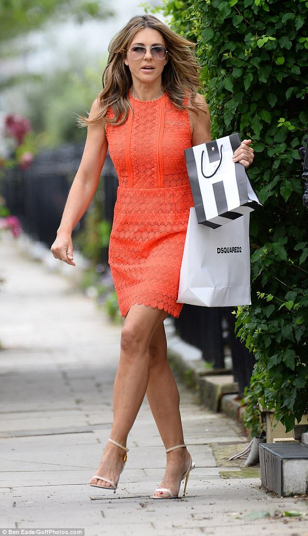 Show-stopper: Elizabeth Hurley made sure she turned heads as she stepped out in London on Friday