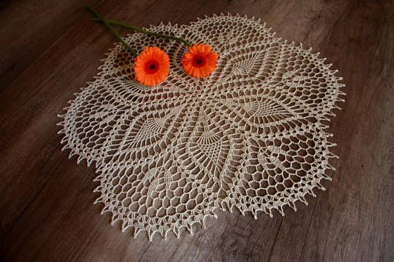 The product is hand-made round crochet, large beige doily. This doily will be an elegant decoration for every table. Draws attention with its uncomplicated pattern. Radial pineapple pattern give an impression of order. Doily is beautiful and elegant. Beige color blends beautifully