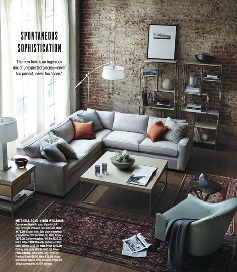 Hardwood floor. Brick wall. Grey couch. Coffee table. Windows. Give me this room now, please.
