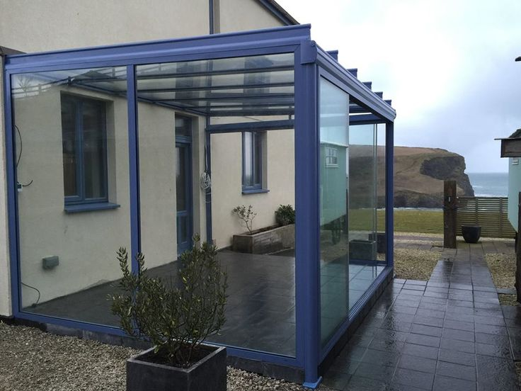 A simplistic, colourful glass house with beautiful views of the coast - Build completed by OpenSpace Living