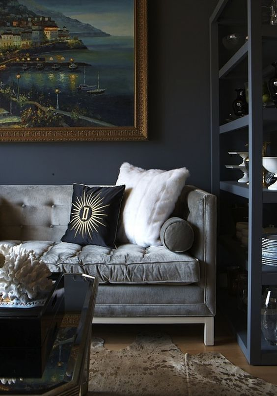 Different shades of grey living room with cozy velvet sofa