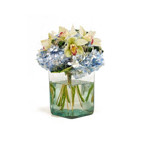 Nube de orquídeas, las hortensias azules armonizan este diseño exclusivo de Adriana Satizabal &