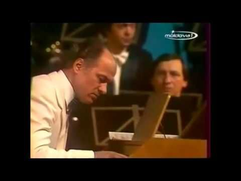 Performed Leningrad Concert Orchestra. Conductor - Anatoly Badhen. Piano - Eugen Doga