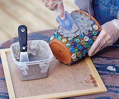 Use broken tiles or china to jazz up a plain pot