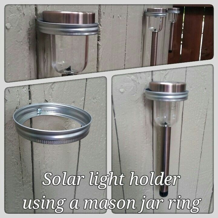 Cheap an easy.... mason jar rings are used to hold solar lights on backyard fence.