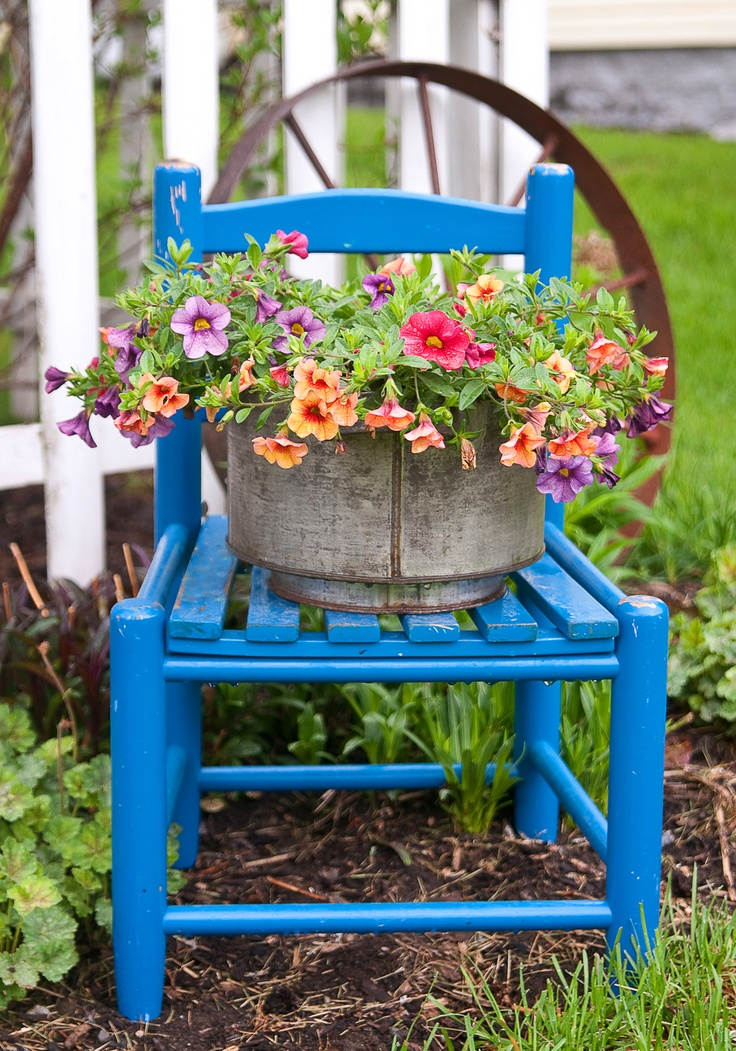 In My Garden Now...Aqua Blue Chair With Million Bells Planted In An