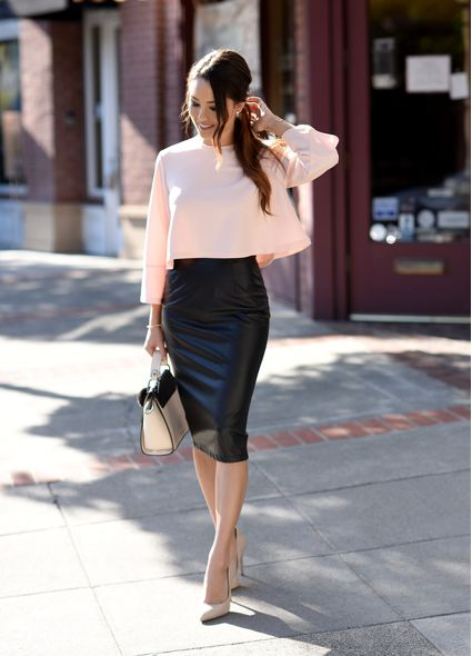Jessica R. opts for a bold faux leather skirt paired with a girly pink top to create a fierce yet feminine style. Pair more punk (leather and jean) pencil skirts with florals, lace, or pastels to create eye-catching contrast. Skirt: Faux Leather,...