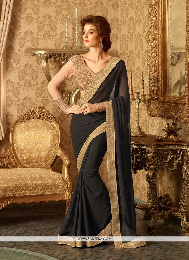 Outstanding craftmanship of embellishments exhibited in this black georgette designer saree. The interesting embroidered and patch border work all through the attire is awe inspiring. Comes with match...