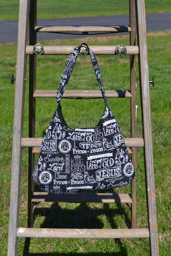 A wonderful everyday bag! This black handbag is the perfect medium size shoulder bag. The exterior of the black and white bag is a religious based