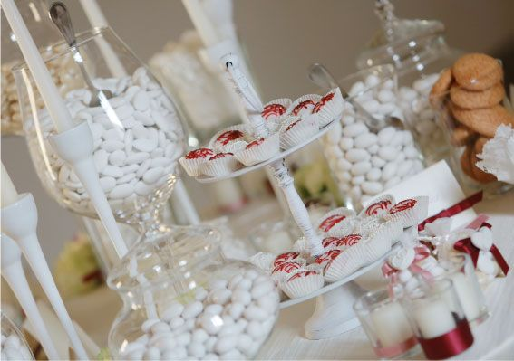Elegant sweet table with dragees and Sardinian sweets.