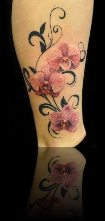 pink orchids floral patterns leg tattoo