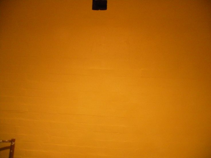 The yellow foundation on the brick wall in the kitchen. /Sara Waters 2014