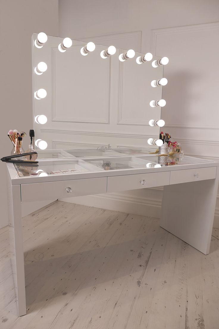 crisp white finish Slaystation make up vanity with premium storage, three spacious drawers encrusted with diamanté cut light reflecting glass handles topped with a show-stopping frosted bulb Hollywood Mirror