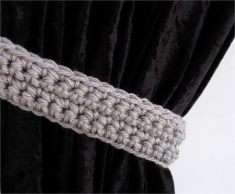 Light Gray CURTAIN TIEBACKS - One Pair, 21 long x 2.25 wide x 1/2 thick   One Pair of Solid Gray Hand-Crocheted Curtain Tiebacks for use with any kind of curtains or drapes, including shower curtains. I used a very thick 100% acrylic yarn called Hometown USA. The color is called Dallas Grey, a light gray. In dimmer lighting, the color looks like a light pewter gray and in brighter or direct sunlight, it looks silvery. This yarn is very soft, smooth, and has a slight sheen.   Different mo...