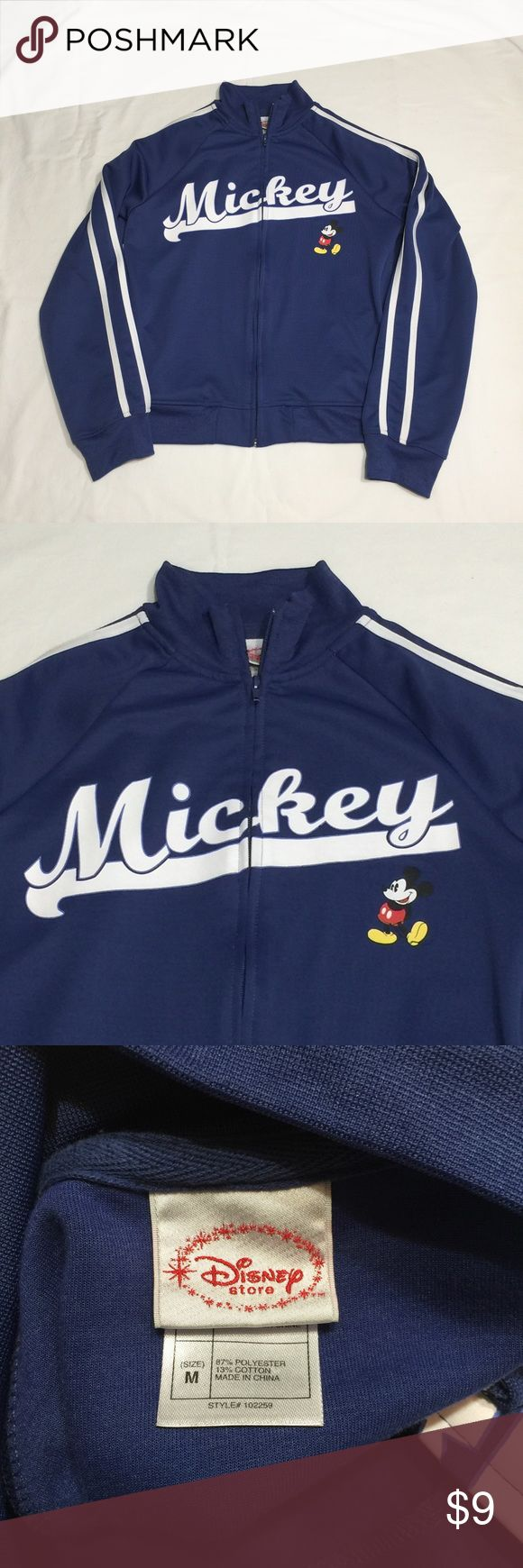 """Mickey Mouse track jacket Size m women's.  Blue zip up.  Has pockets.  22"""" long. 18"""" across front polyester cotton blend.  Mickey front.  Plain blue back. Nice like new condition from the Disney store Disney Jackets & Coats"""