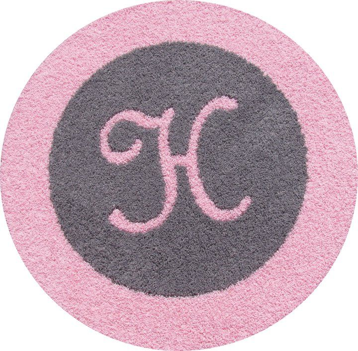Round Gray Rug With Light Pink Border And Initial.