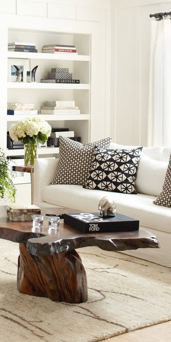Loving this modern black & white living room with rustic wood coffee table and drum pendant lighting