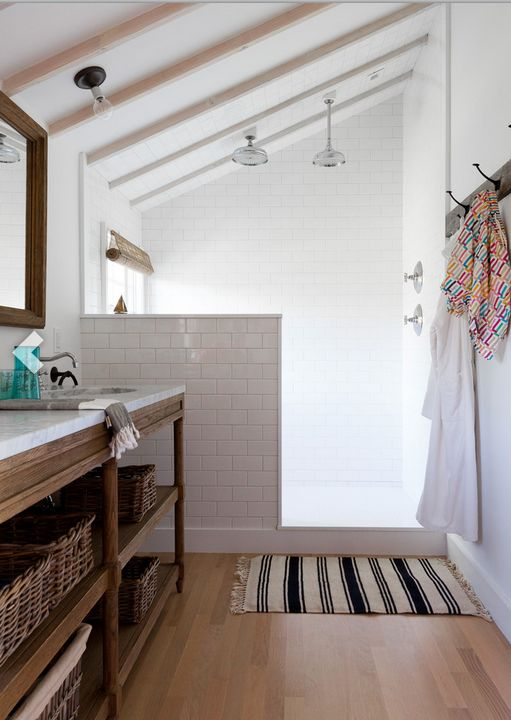 ****great walk-in shower separated by half wall in long narrow bath, add hand shower head, open shelves under vanity counter, nice mix of wood and white tile, prefer mix hooks and towel rod, bench in shower, cottage/country farmhouse style w/ industrial elements
