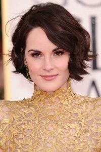 <center>One of Michelle\'s best ever styles is this tousled wavy bob. So simple yet oh-so stylish.