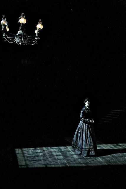 There is not much light on the stage so you cant really see what the actress if thinking.