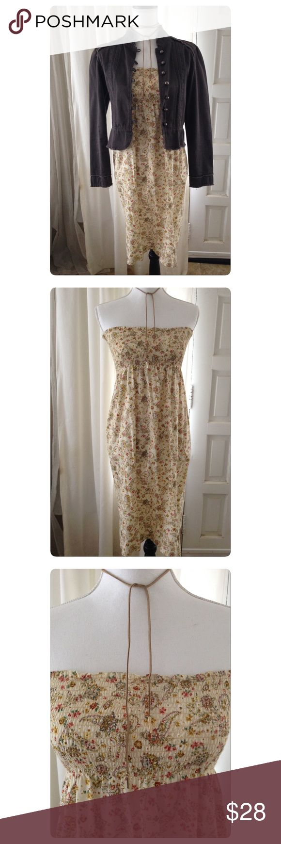 Smocked Top Dress Smocked top strapless dress in shades of a soft yellow, rust and brown paisley and floral print. Style it Boho or pair it with your favorite cowboy boots and fringe bag! Dresses Strapless