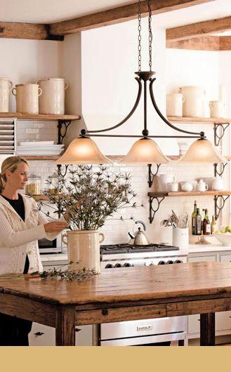 cast iron large three pendant lighting fixture above a kitchen table - Kitchen Table Light