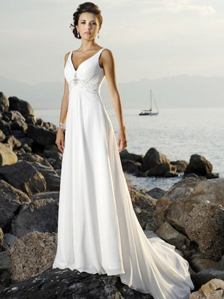Classically gorgeous! This A-line dress with deep V-neck and crystal and bead embellished empire waist is perfect for any venue whether it is a destination beach wedding or a traditional church weddin
