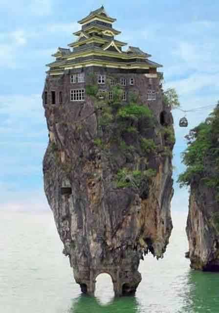 """Blog Hoax-Slayer: The Amazing """"Rock House"""". The image is a Photoshop creation rather than a genuine photograph of a real house. It is an entry in the Bizarrchitecture 3 Photoshop contest conducted by Worth1000. The entry was created by Norrit and is titled Bond Mansion."""