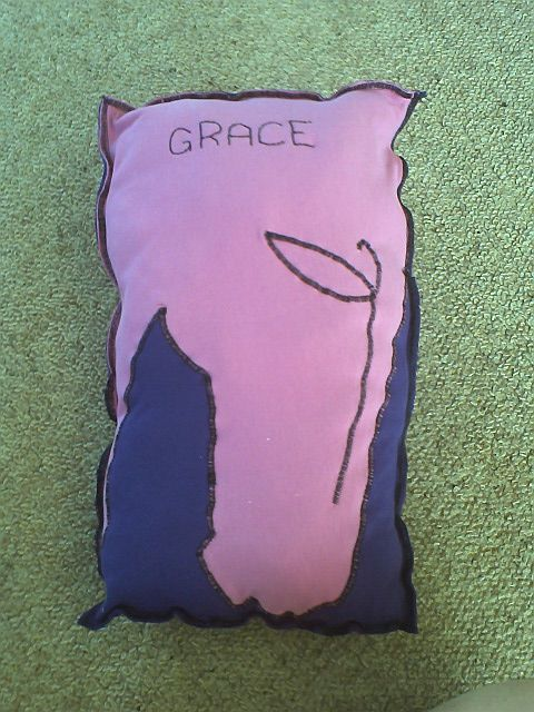 An appliqued cushion with the personal touch for Grace.