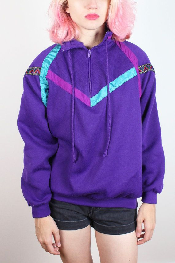Vintage sweatshirt. Purple. Teal, purple, and southwestern stripe detailing at chest and shoulder front. Plastic zipper v neck front. Cinch nack ties. Unlined. Slouch fit. *notes: light pilling/fuzzing wear. Shoulder Width:  Bust: 46 Waist: 32-44 Hips:  Length: 25 Tag: PennyLane. L. 85% polyester 15% cotton Fits Like: M/L  Accessories are not included unless listed in the item description For reference the model is 57, and a US size 2.     **PAYMENT/ SHIPPING/ REFUNDS&#x2F...
