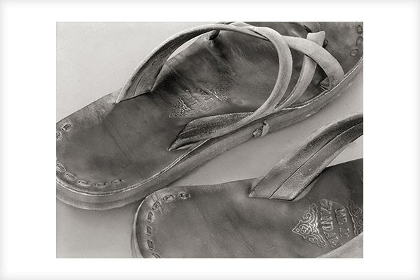 """""""Bruce's Jandals"""" is a fine art photograph by Jonathan Bourla.  This close up photograph was taken with a large format view camera similar to the plate cameras of one hundred years ago.  This limited edition photograph is printed on one hundred percent acid-free cotton rag paper with pigment ink.  To see more of Jonathan's photographs, go to www.jonathanbourla.com"""