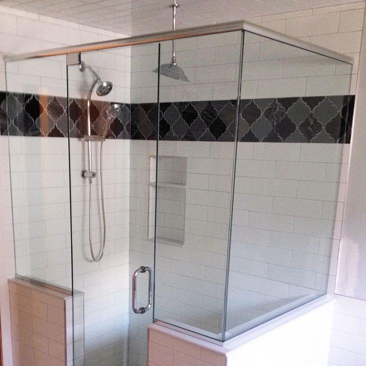 a little moroccan arabesque tile as a shower border black and white shower black