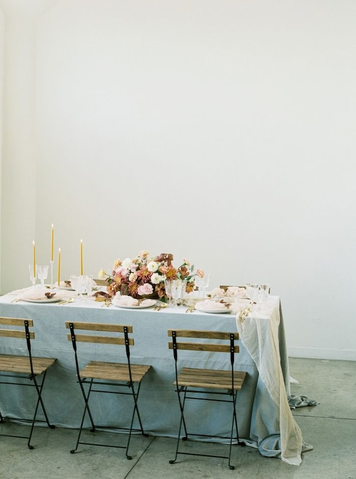 romantic intimate wedding reception table scape with fall inspired flowers