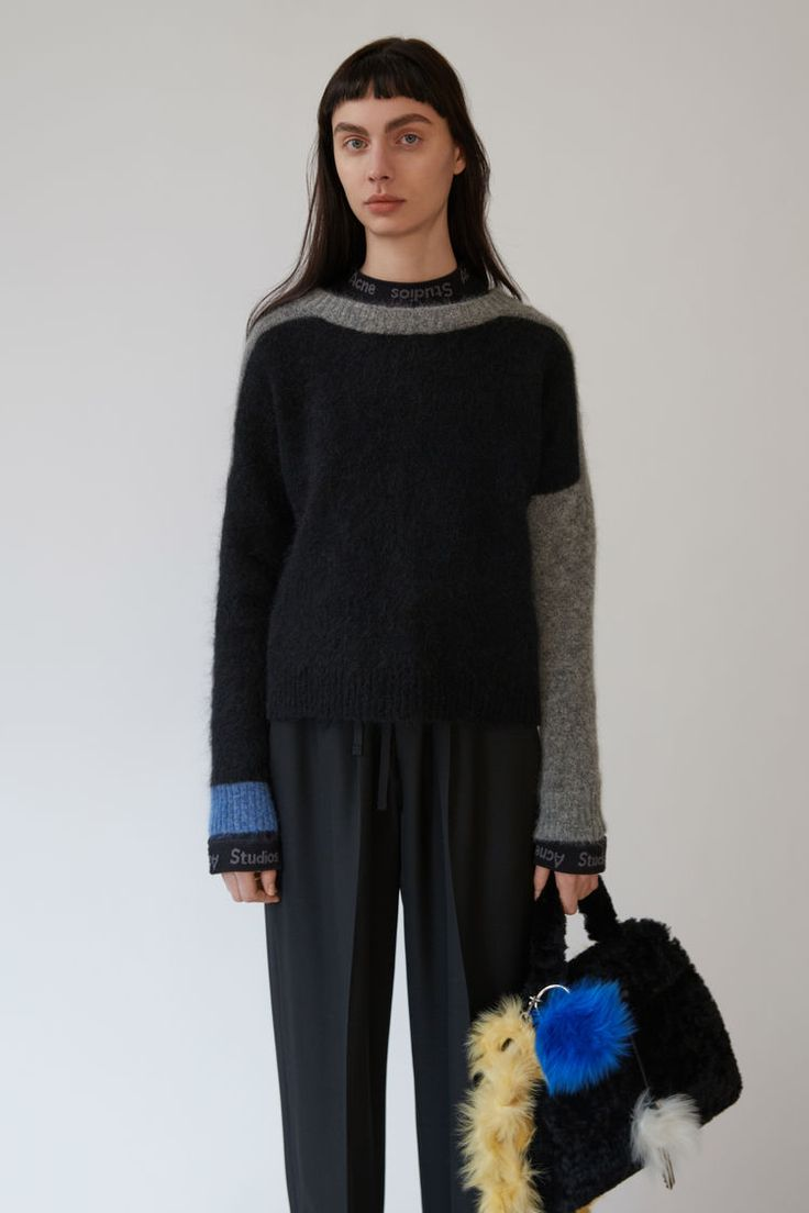Acne Studios Rafa Block black combo is a crewneck sweater with distinctive colourblocking.
