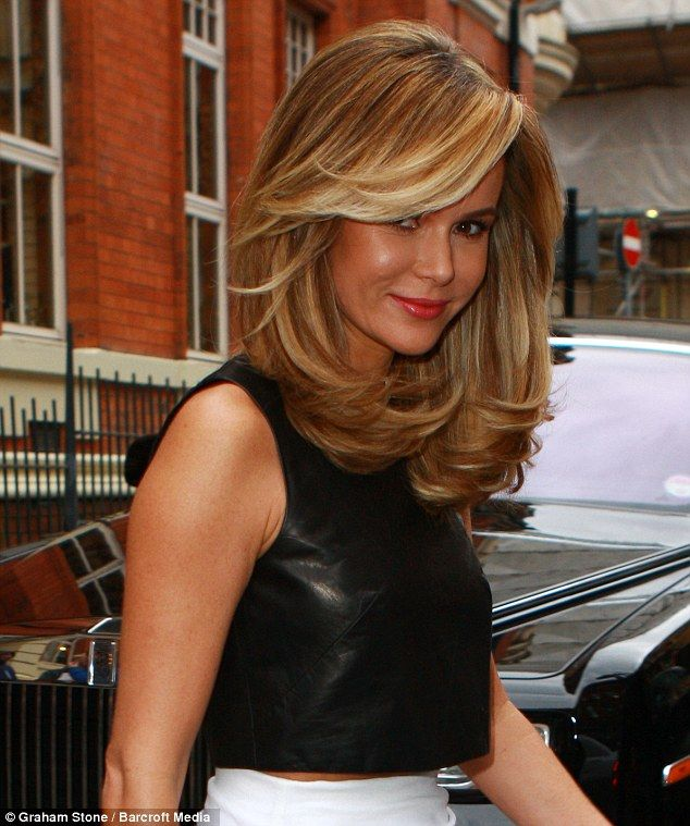 Great hair: The star had amazingly thick hair as she stepped out of her hotel on Monday morning